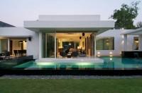 แบบบ้านปูน ชั้นเดียว บ้านหรู มาพร้อมกับสระว่ายน้ำ