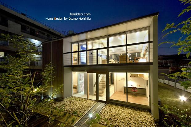 แบบบ้านกระจก 2 ชั้น ตกแต่งสวนหินหลังบ้าน