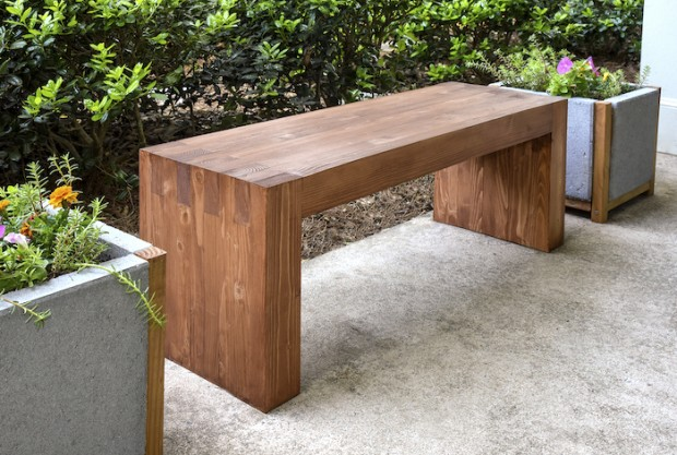 wood bench with paver planter