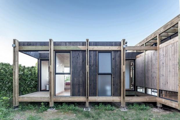 บ้านโฒเดิร์นโครงสร้างไม้ผนังกระจก
