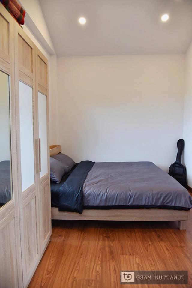 ห้องนอนตกแต่งลายไม้