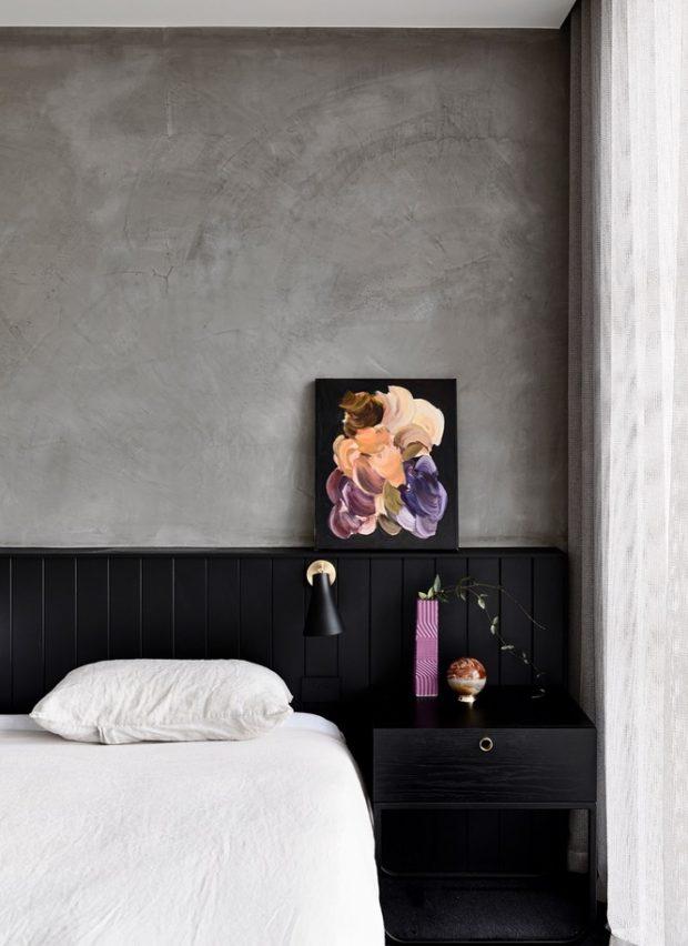 ห้องนอนผนังคอนกรีตตัดสีดำ