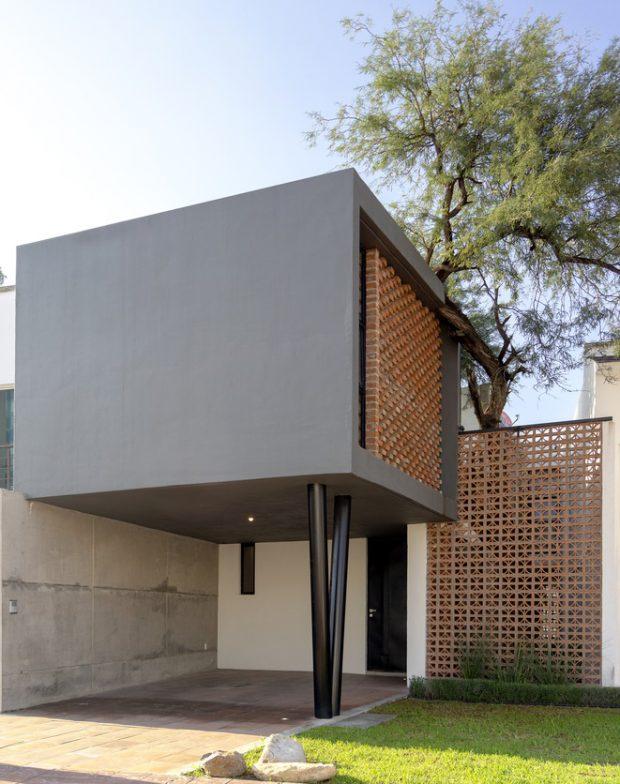 บ้านกล่องสีดำตกแต่งอิฐ