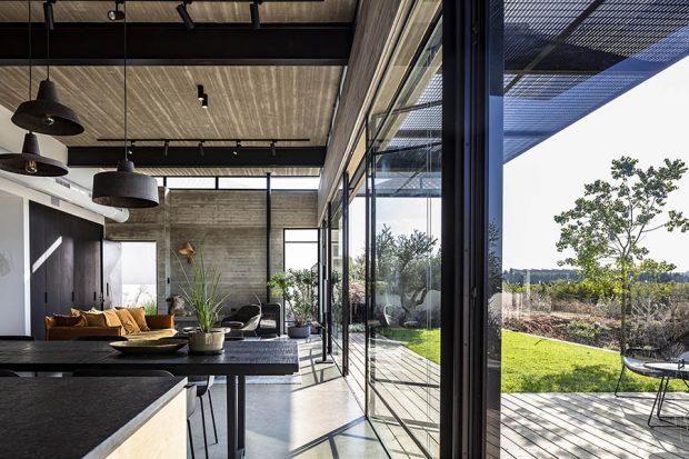 บ้านโครงสร้างคอนกรีตผนังกระจก