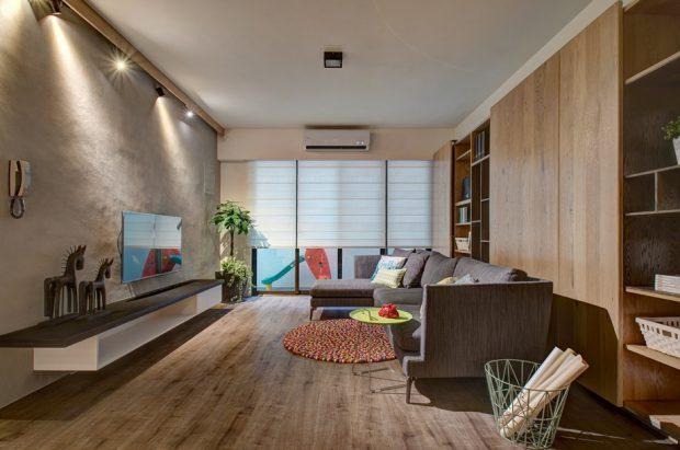 ห้องนั่งเล่นผนังคอนกรีตและไม้