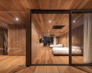 ห้องนอนตกแต่งไม้ผนังกระจก