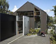 บ้านสีดำตัดกับคอนกรีต