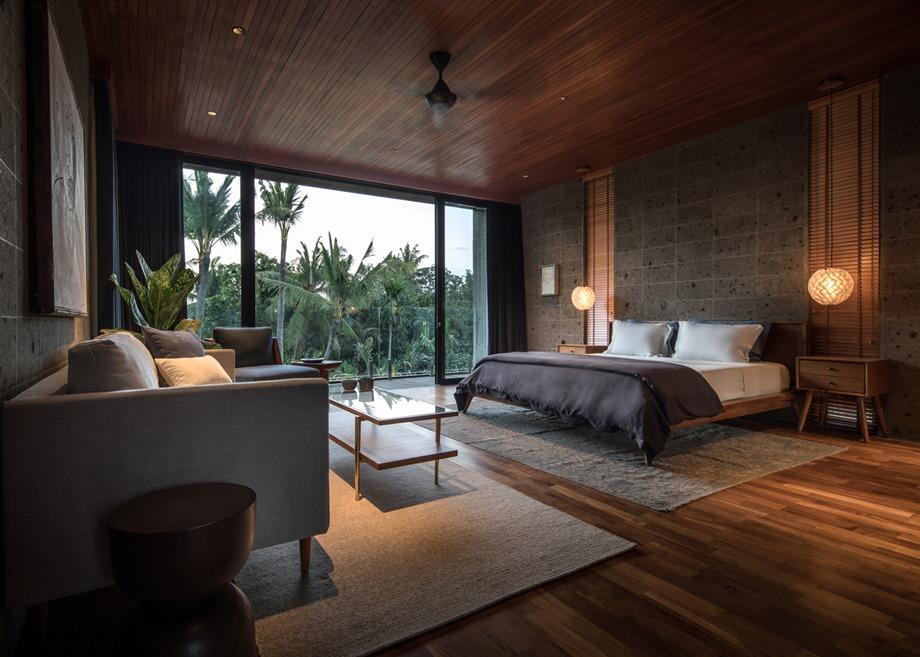 ห้องนอนตกแต่งคอนกรีต ไม้ ผนังกระจก